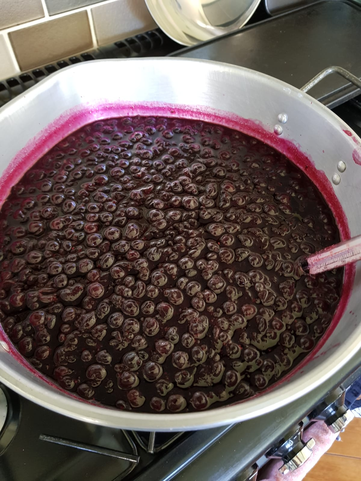 Blackcurrant jam in pan